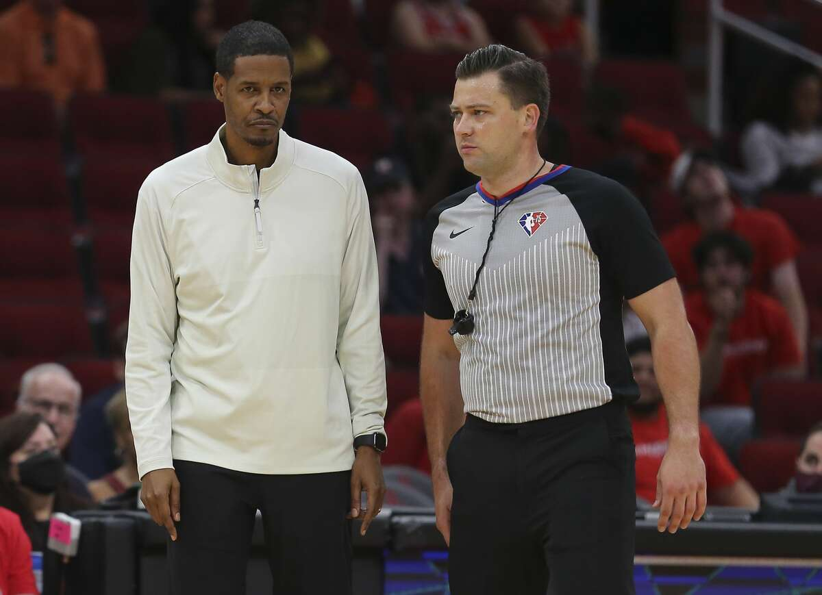 Houston Rockets head coach Stephen Silas has a conversation with referee Gediminas Petraitis (50) during the fourth quarter of a NBA preseason game against the Miami Heat Thursday, Oct. 7, 2021, at Toyota Center in Houston. The Rockets lost to the Heat 106-113.