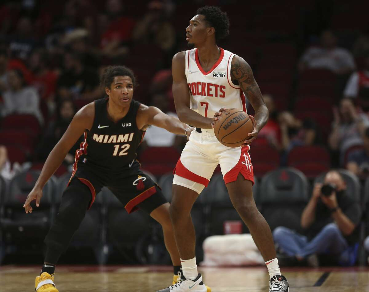 Houston Rockets guard Armoni Brooks (7) looks for a pass while Miami Heat guard Dru Smith (12) is guarding during the fourth quarter of a NBA preseason game Thursday, Oct. 7, 2021, at Toyota Center in Houston. The Rockets lost to the Heat 106-113.