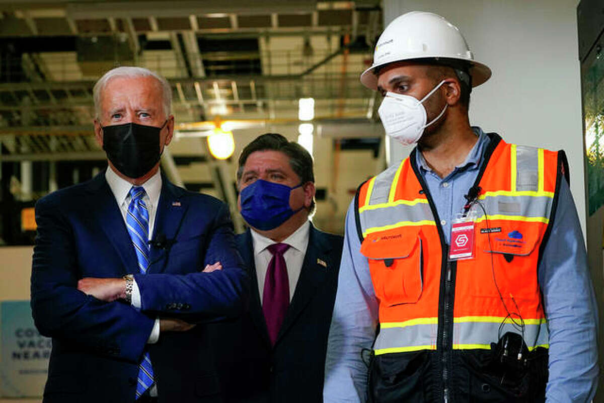 President Joe Biden tours a Clayco Corp. construction site for a Microsoft data center in Elk Grove Village on Thursday with Gov. J.B. Pritzker and employee Anuraj Jhajj.