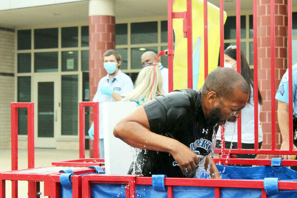 Principal Allen Duncan gets dunked at Liberty Middle School to celebrate hitting a fundraiser goal for Kellsie's Hope Foundation in Maryville.