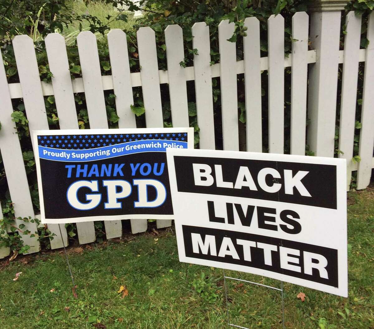 A Greenwich Police Department lawn sign next to a Black Lives Matter sign in Greenwich.