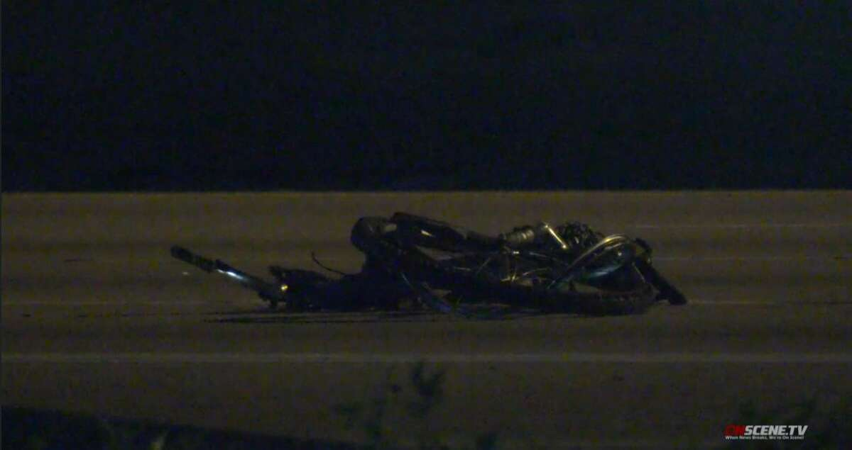 A man apparently walking his bicycle on the Eastex Freeway died in a crash involving three vehicles late Thursday night, according to the Harris County Sheriff's Office and OnScene TV.