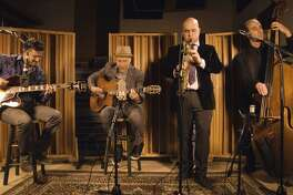 The Milford Arts Council, The MAC, performing arts theater, and the Founders House Pub & Patio, are hosting a special gypsy swing jazz brunch with doors opening at 11:30 a.m., and a performance concert starting at 12:15 p.m., on Sunday, October 31, at The MAC, with New York-based veteran guitarist Doug Munro, and his gypsy swing group, La Pompe Attack, performing. There will also be a cash bar. Munro, center, and the other members of his band, is shown. October 31, is the holiday, Halloween.