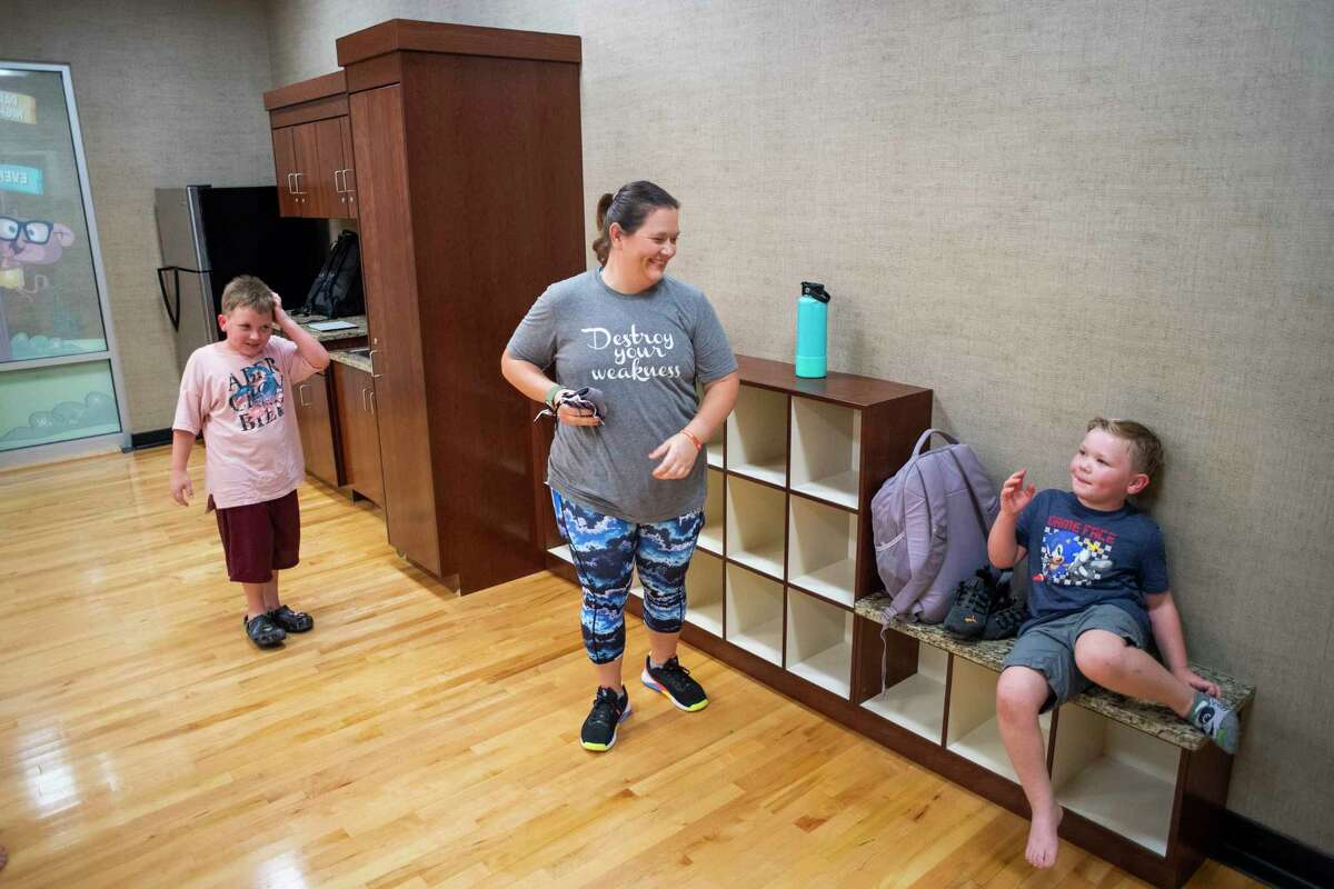 Danielle Goodspeed with her sons Paxton, left, and Bryson after their workout class in Life Time on Friday, Sept. 24, 2021, in Cypress, Texas.