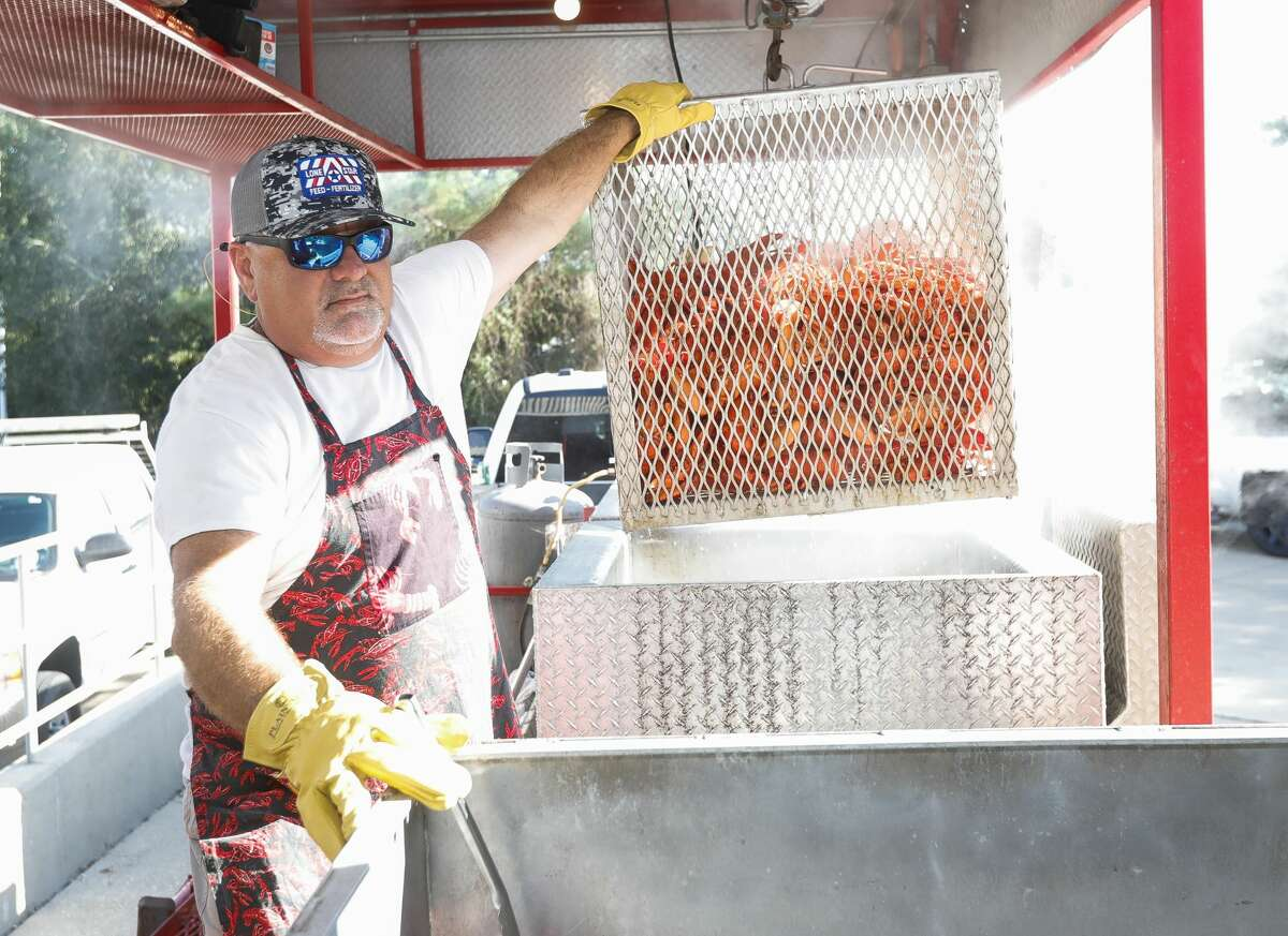 Scott Knee loads boiled lobsters for the Conroe/Lake Conroe Chamber of Commerce?•s annual Lobsterfest at the Lone Star Convention Center, Thursday, Oct. 7, 2021, in Conroe. Hundreds of people attended the surf n turf dinner, which is fundraiser for the chamber.