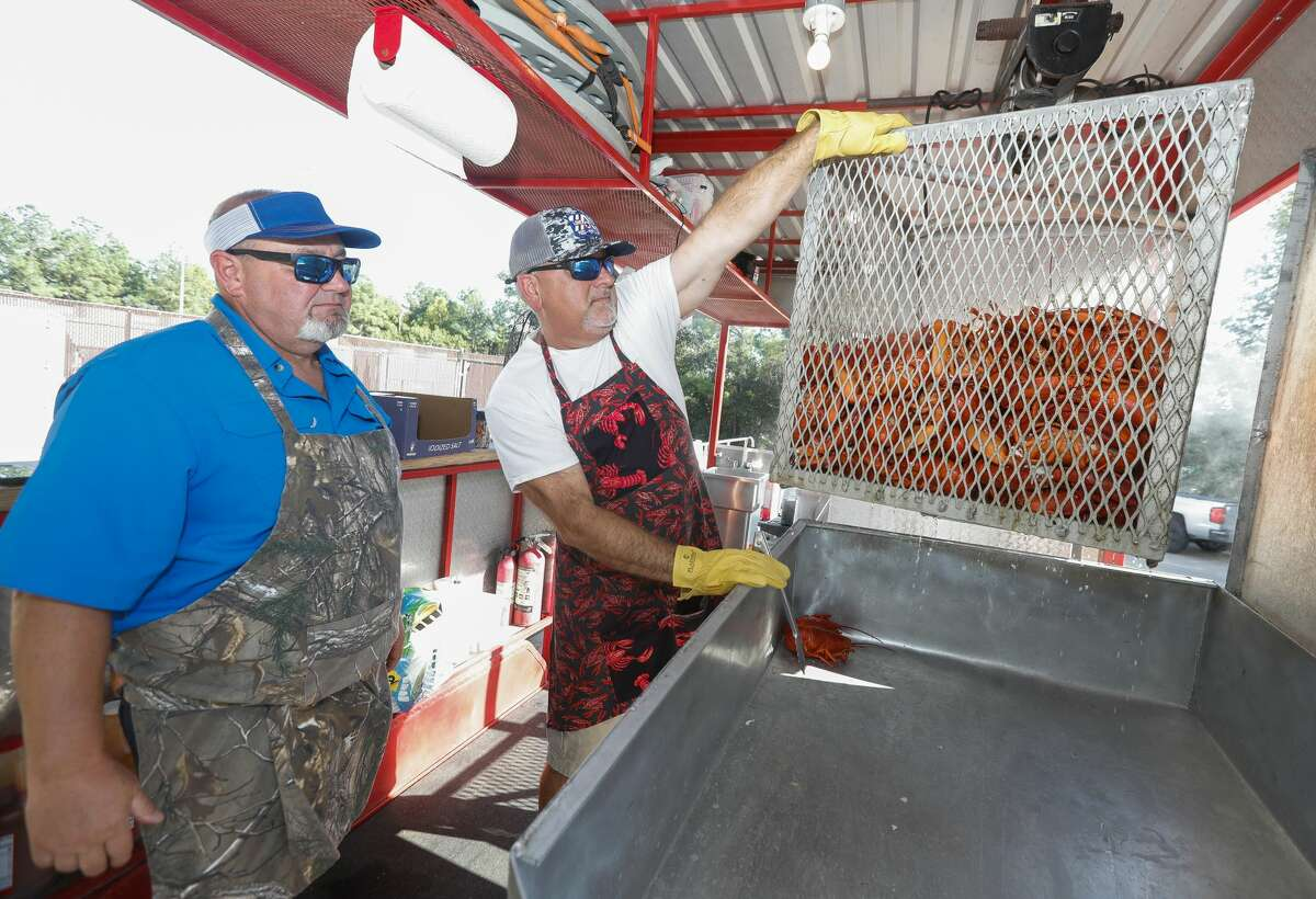 prepare steaks and lobsters for the Conroe/Lake Conroe Chamber of Commerce?•s annual Lobsterfest at the Lone Star Convention Center, Thursday, Oct. 7, 2021, in Conroe. Hundreds of people attended the surf n turf dinner, which is fundraiser for the chamber.