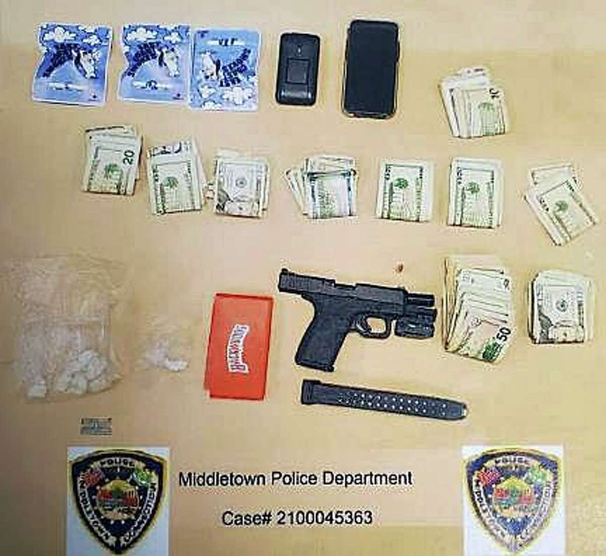 During a traffic stop Wednesday, Middletown police said they seized from a suspect's vehicle a handgun with extended 31-round magazine loaded with 25 rounds, and one in the chamber. They also allegedly discovered nearly 26 grams of crack cocaine, drug paraphernalia, multiple cellphones and a large amount of cash.