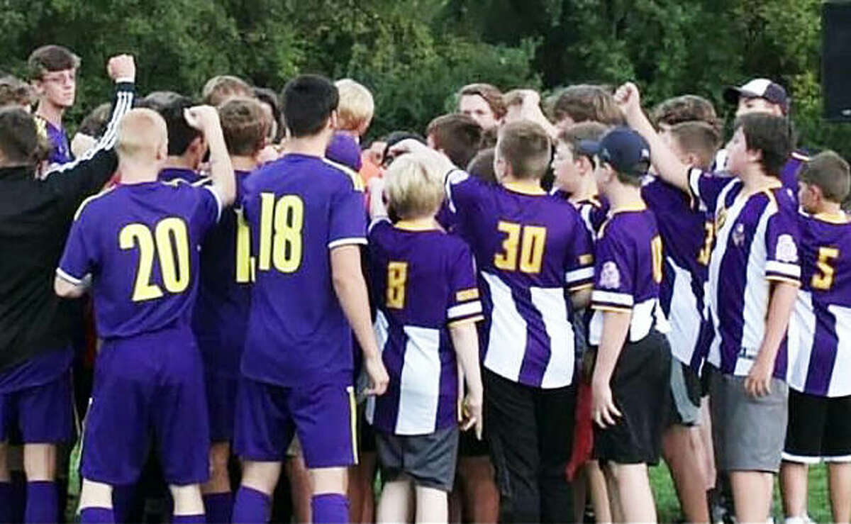 Players from the Bethalto FC youth soccer club join the Civic Memorial Eagles in a display of unity prior to Thursday night's Mississippi Valley Conference game against Jersey at the Bethalto Sports complex.