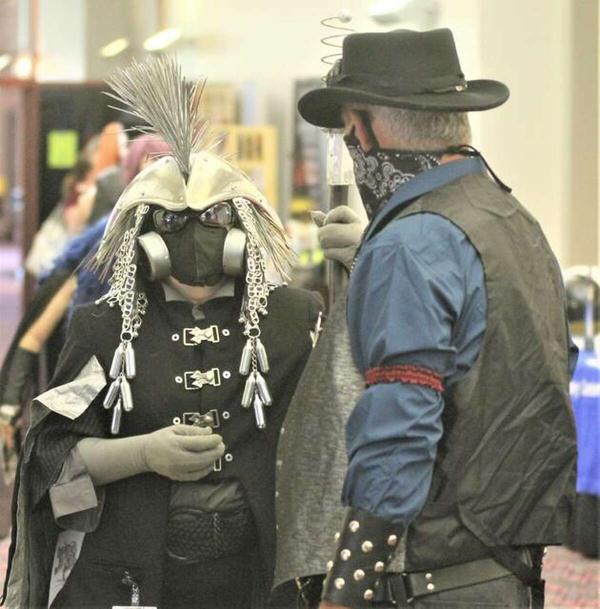 """Snail Scott, left, a St. Louis-based sculptor wearing a costume she describes as """"Post-Apocalyptic Plague Shaman,"""" talks with another participant at Archon, the region's premier Sci-Fi/Fantasy convention last weekend."""
