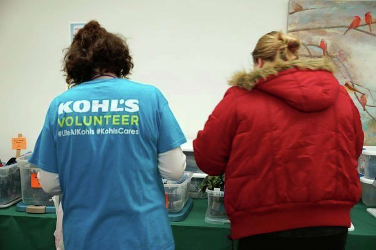 A Kohl's employee assists parent shopper at a prior year's Community Christmas Closet. (File photo/Midland Daily News)