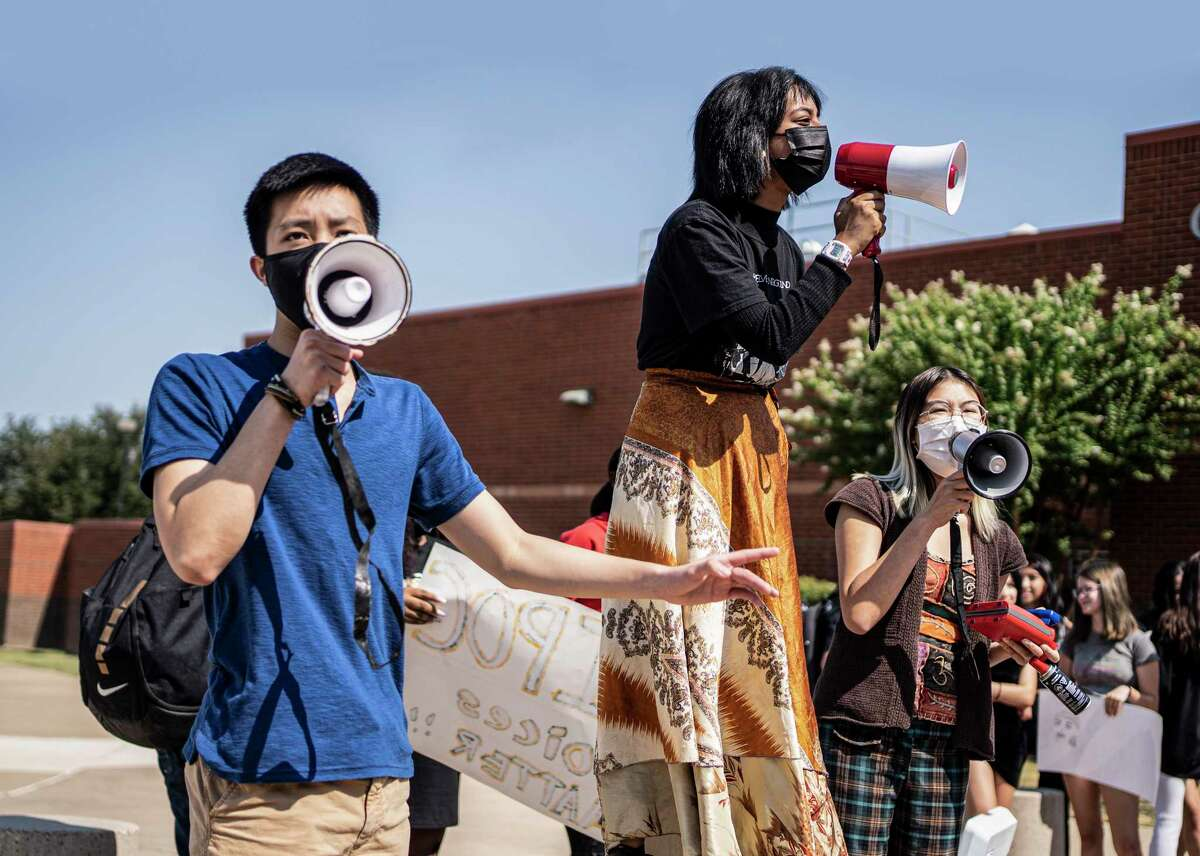 Sean Vo, 18, Sunehra Chowdhury, 17, and Grace Nguyen, 17, lead a student walk-out in early September at Colleyville Heritage High School to protest the suspension of their high school's first Black principal, James Whitfield.