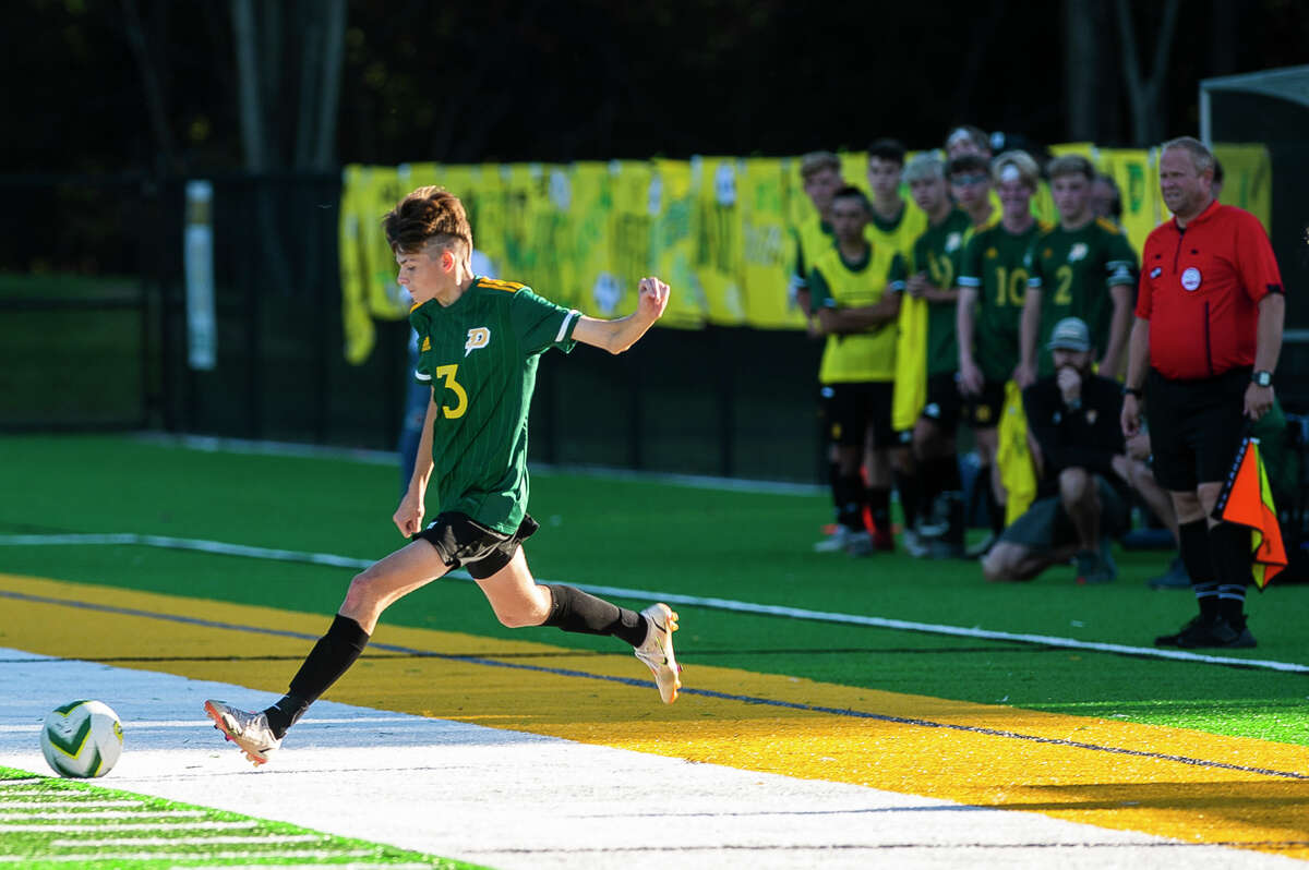 Dow High's Jonah Dahn takes a free kick during a Sept. 29, 2021 game against Midland High.