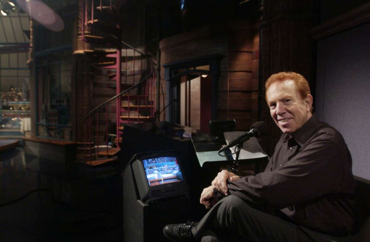 """Alan Kalter at his work station on the corner of the """"Late Show with David Letterman"""" stage in New York on Nov. 20, 2003. Kalter, a longtime Stamford, Conn., resident, died Monday at age 78."""