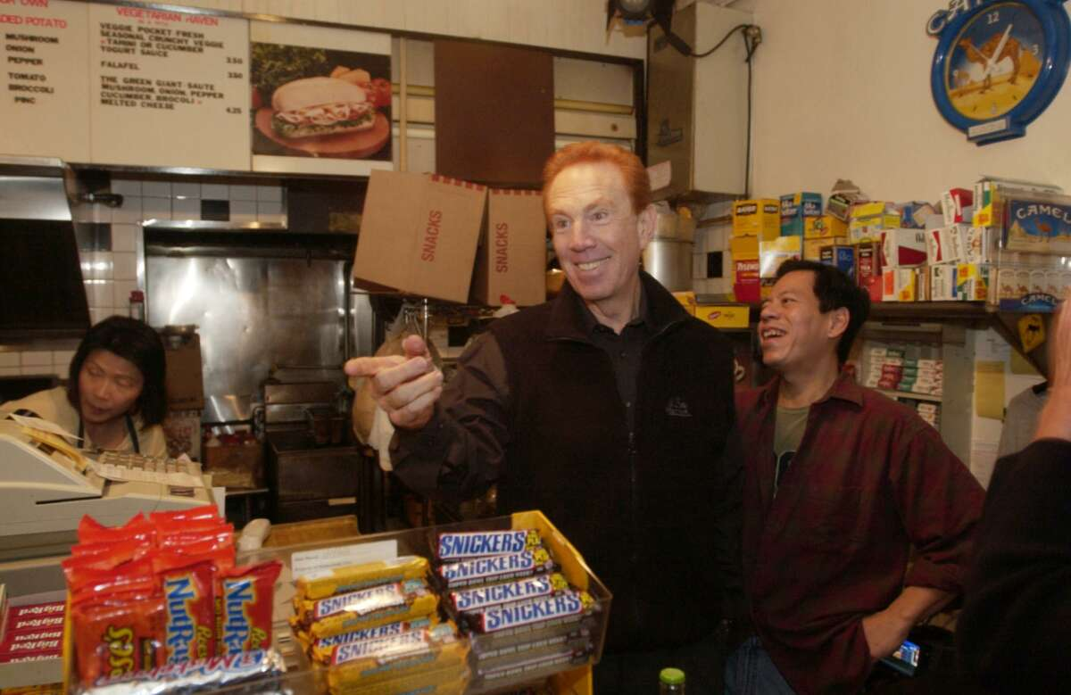 """Alan Kalter, then the announcer for """"Late Show with David Letterman,"""" visits Rupert Jee of Hello Deli, next to the Ed Sullivan Theatre's stage entrance on Nov. 20, 2003. Kalter, a longtime Stamford, Conn., resident, died Monday at age 78."""