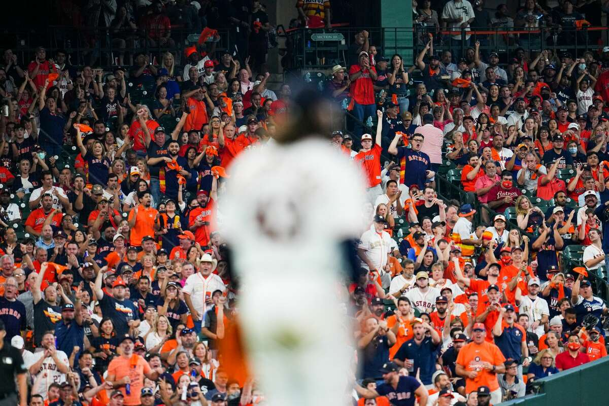 HOUSTON, TX - OCTOBER 07: Fans cheer during an inning break during Game 1 of the ALDS between the Chicago White Sox and the Houston Astros at Minute Maid Park on Thursday, October 7, 2021 in Houston, Texas. (Photo by Cooper Neill/MLB Photos via Getty Images)