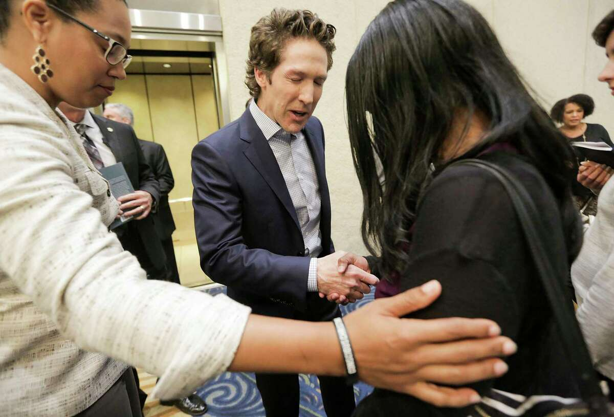 After service, Osteen meets with attendees for prayer or book signing. Service at Lakewood Church on Sunday, April 22, 2018, in Houston. Images for a four-part series on it's pastor, Joel Osteen.