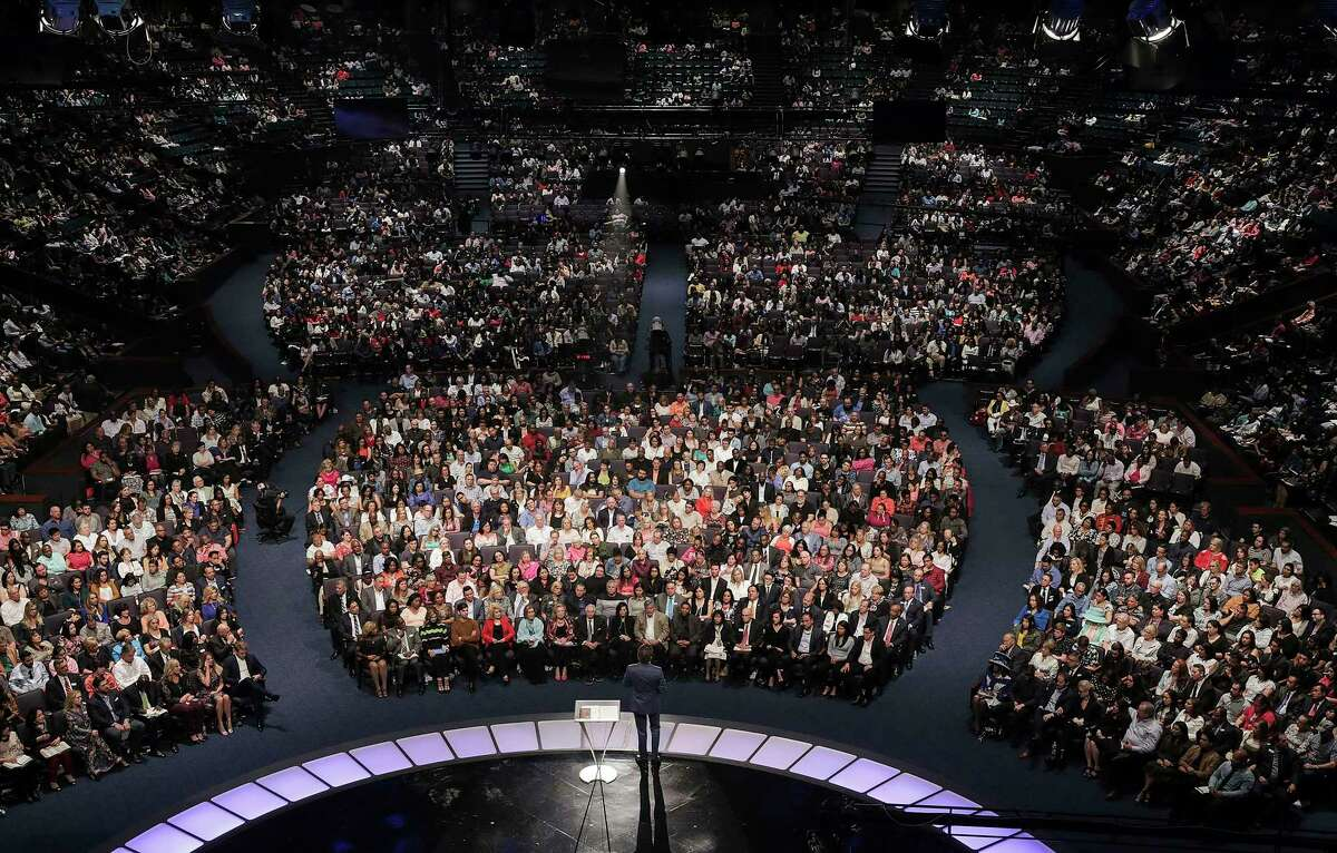Lakewood Church pastor Joel Osteen takes to the stage for his sermon on Sunday, April 22, 2018, in Houston. Images for a four-part series on it's pastor, Joel Osteen. ( Elizabeth Conley / Houston Chronicle )