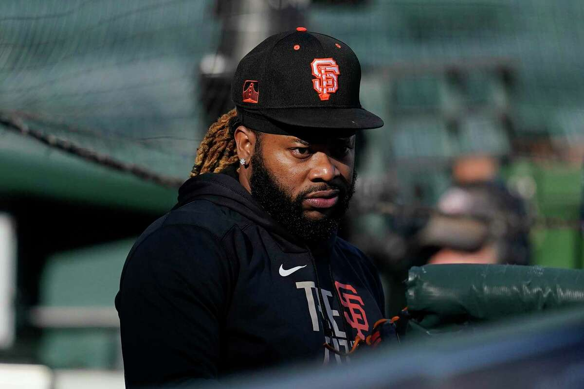 San Francisco Giants pitcher Johnny Cueto stands in the dugout during a baseball practice in San Francisco, Tuesday, Oct. 5, 2021. (AP Photo/Jeff Chiu)