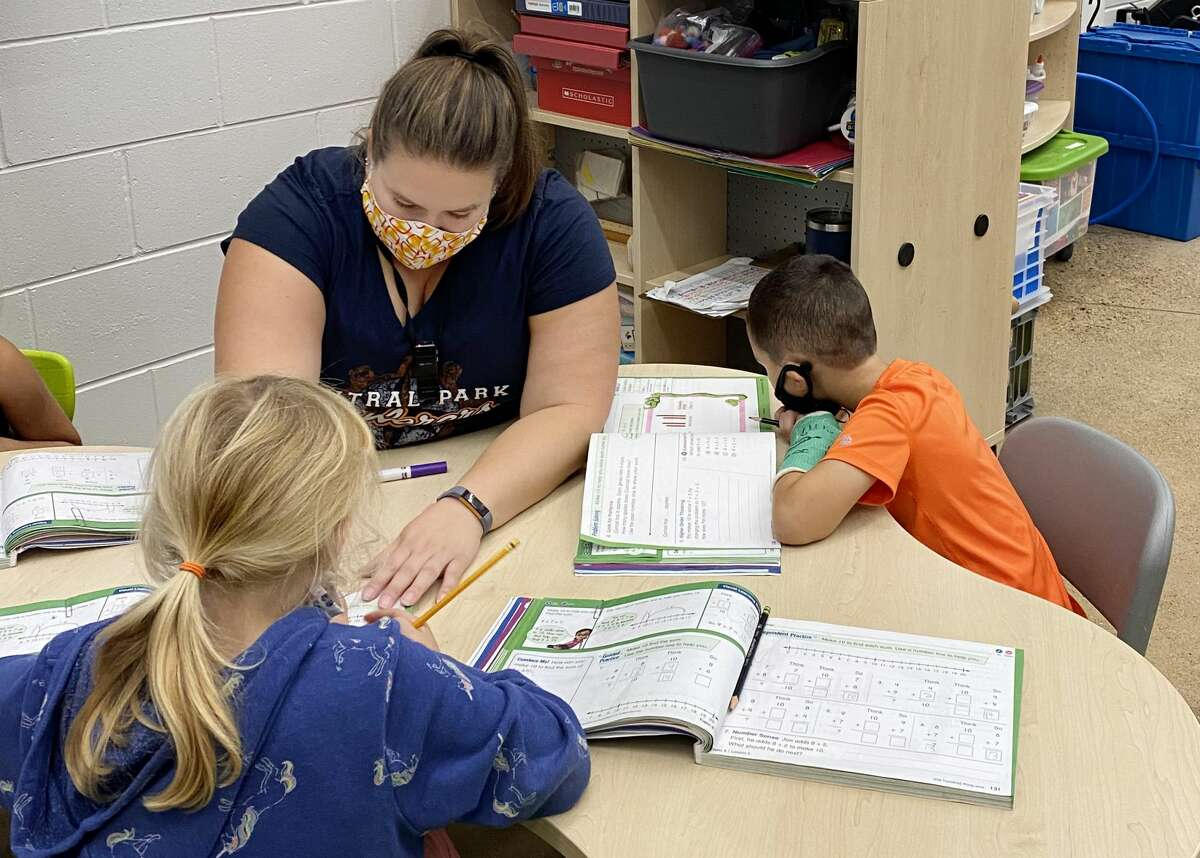 Sarah Cooper, center, works with children in her first grade classroom Friday, Oct. 8, 2021 at Central Park Elementary in Midland. (Photo provided/Kara Stark)