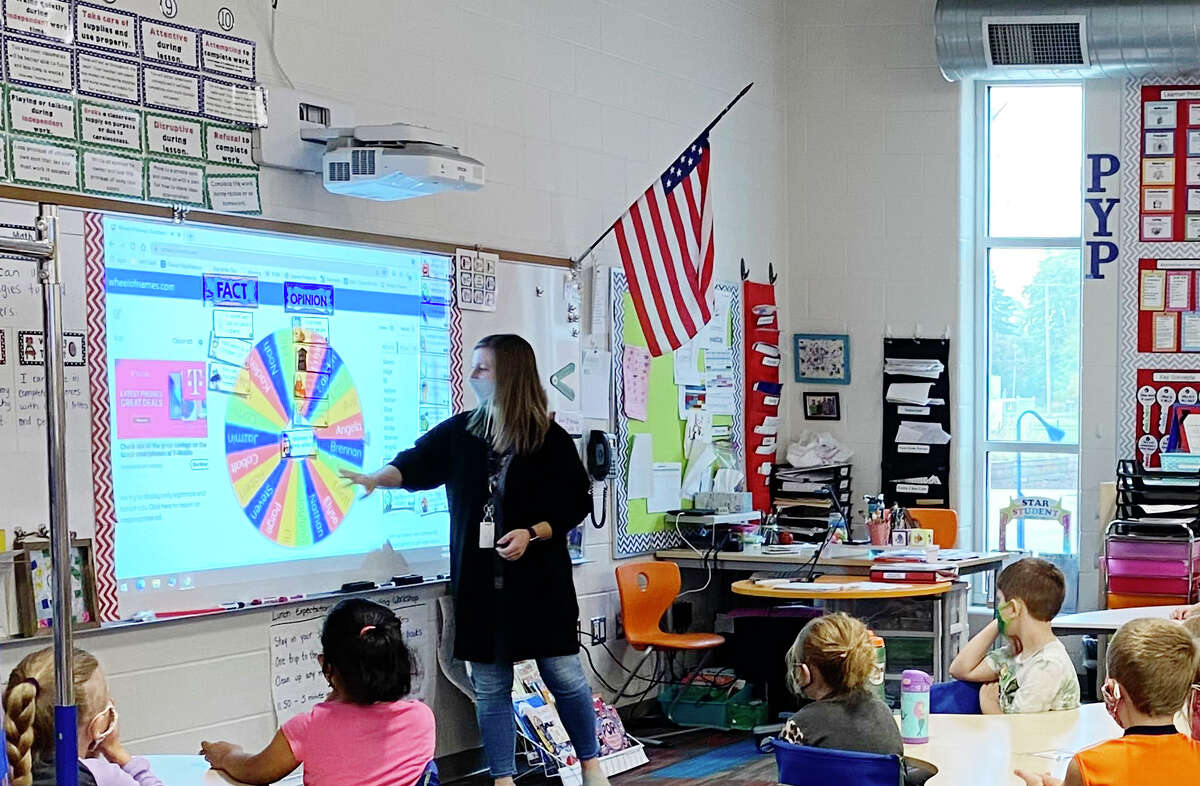 Katie Kret works with children in her second grade classroom Friday, Oct. 8, 2021 at Central Park Elementary in Midland. (Photo provided/Kara Stark)