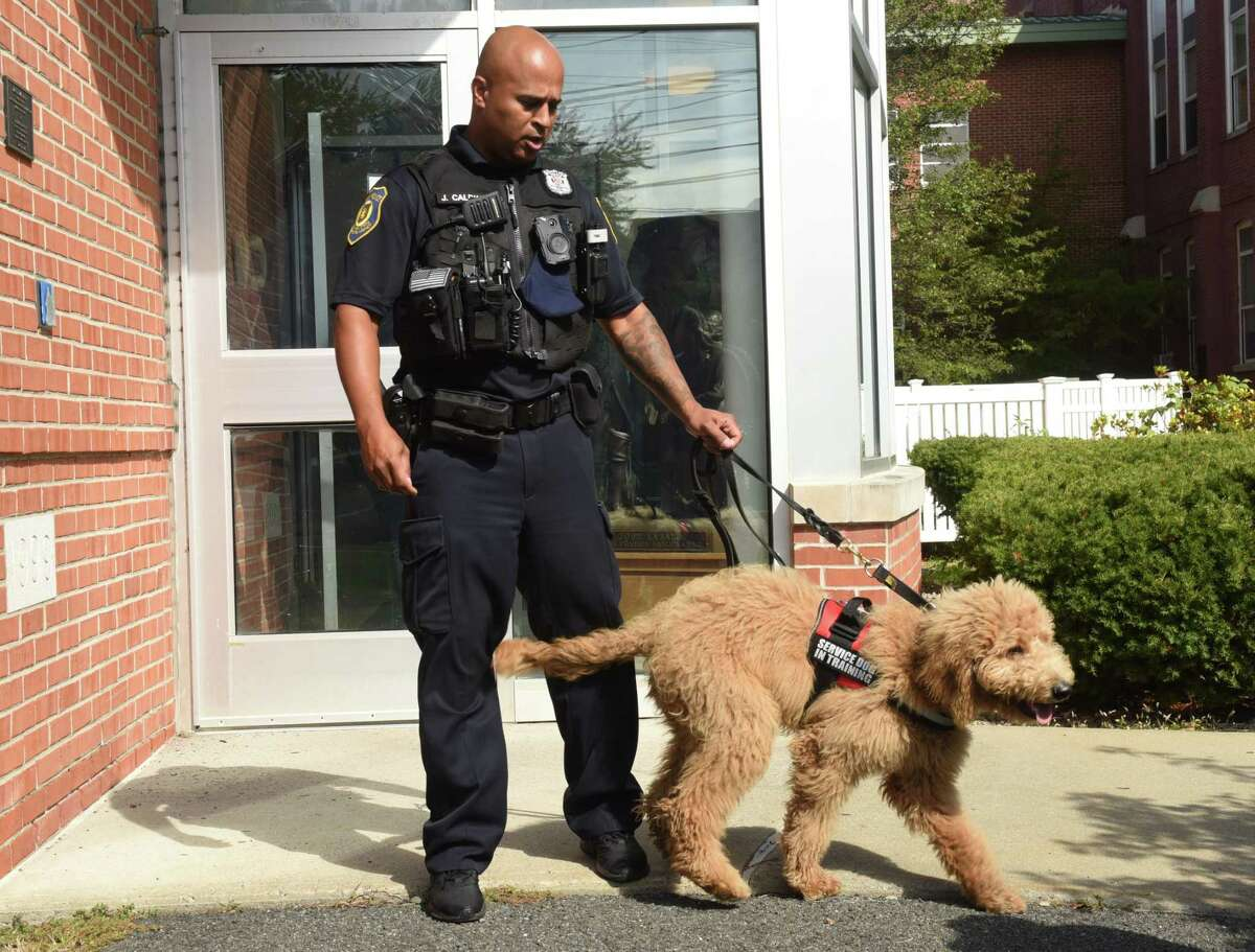 Officer Joel Caldwell, with police therapy dog Charlie, discusses how the dog is used in police work including an incident earlier this week involving a teen in distress at LaSalle School on Friday, Oct, 8, 2021 in Albany, N.Y.