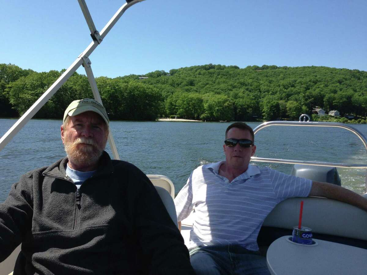 Don MacMillan, left, with his son, Kevin, on Candlewood Lake.