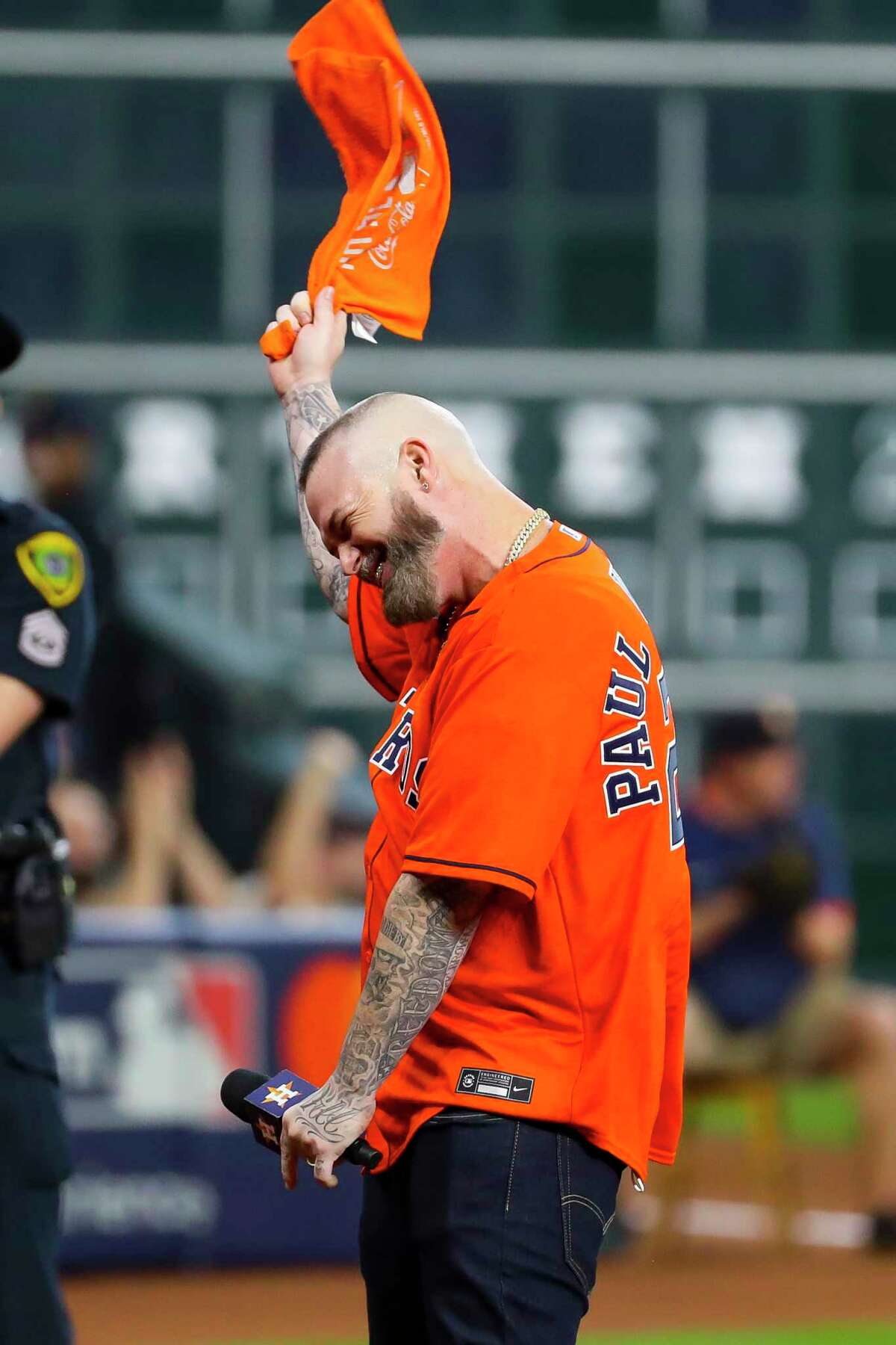 """Paul Wall makes the """"play ball"""" call before Game 2 of the American League Division Series on Friday, Oct. 8, 2021, at Minute Maid Park in Houston."""