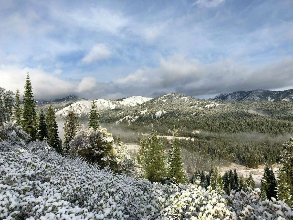 A light snow covers the mountain tops overlooking the Euer Valley, near Truckee. One to 3 inches of snow was expected over the weekend in the Sierra.