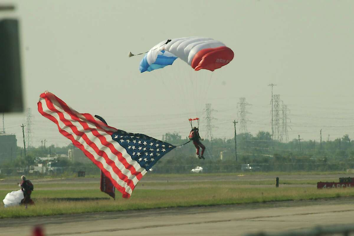 A member of the Re/Max Skydive Team brings the flag to the ground.