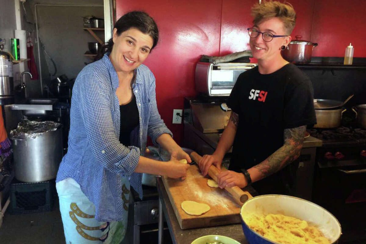 The restaurant does not have a chef, so volunteers do the cooking. Elis Herman, left, and Edith Reiner make pirozhki.