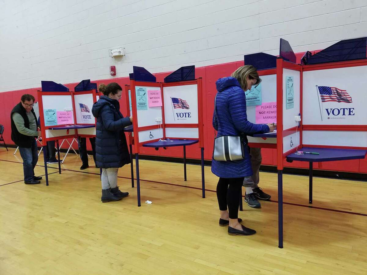 New Canaan residents voice their choices for town leaders on Election Day.