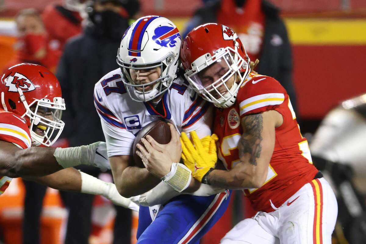 KANSAS CITY, MISSOURI - JANUARY 24: Josh Allen #17 of the Buffalo Bills is tackled by Tyrann Mathieu #32 and Alex Okafor #57 of the Kansas City Chiefs in the second half during the AFC Championship game at Arrowhead Stadium on January 24, 2021 in Kansas City, Missouri. (Photo by Jamie Squire/Getty Images)