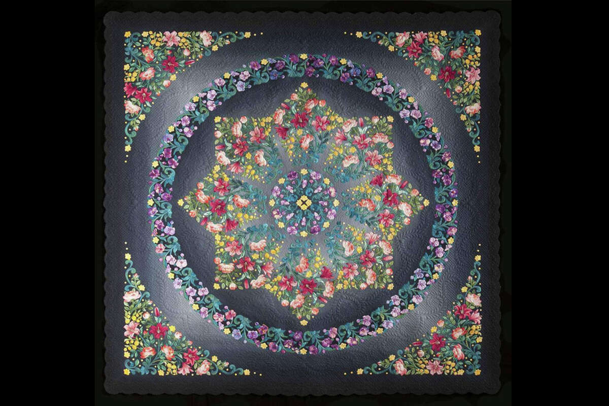 """Sachiko Chiba of Morioka City, Iwate, Japan won the Handi Quilter Best of Show Award for the 2021 International Quilt Festival. Chiba's 80-inch by 80-inch quilt is titled """"Rondo"""" and includes floral fabric in a variety of colors. The honor includes a $12,500 prize."""