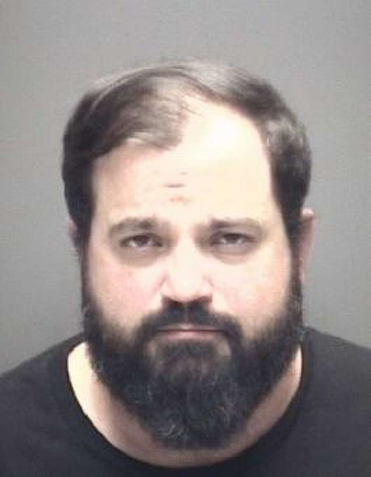 Justin Popovich was arrested three times and charged with violating bond and stalking during April 2020.