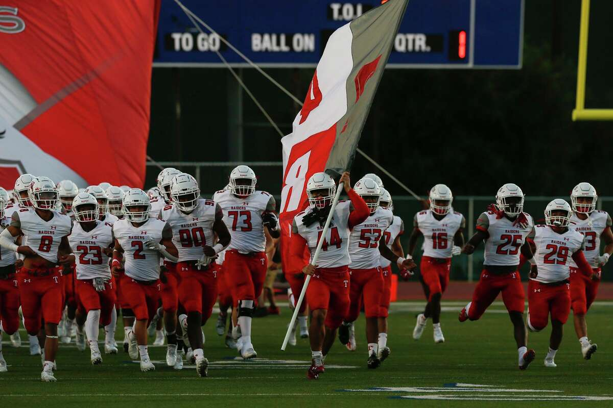 Taft's Brandon Halligan (44) leads the way as the Raider rush the field before the start of the game against the Brennan Bears at Gustafson Stadium in San Antonio, Texas, Thursday, Oct. 7, 2021.