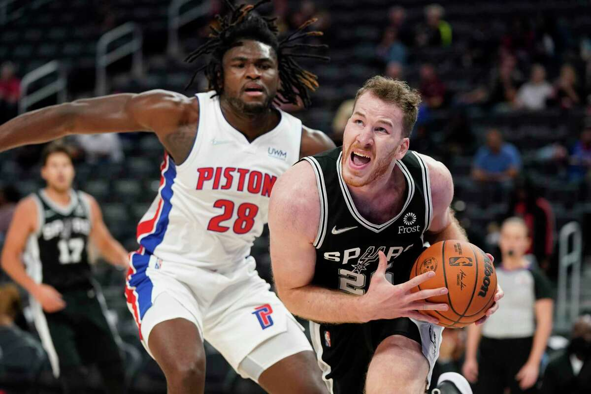 San Antonio Spurs center Jakob Poeltl (25) drives to the basket as Detroit Pistons center Isaiah Stewart (28) defends during the first half of a preseason NBA basketball game, Wednesday, Oct. 6, 2021, in Detroit. (AP Photo/Carlos Osorio)