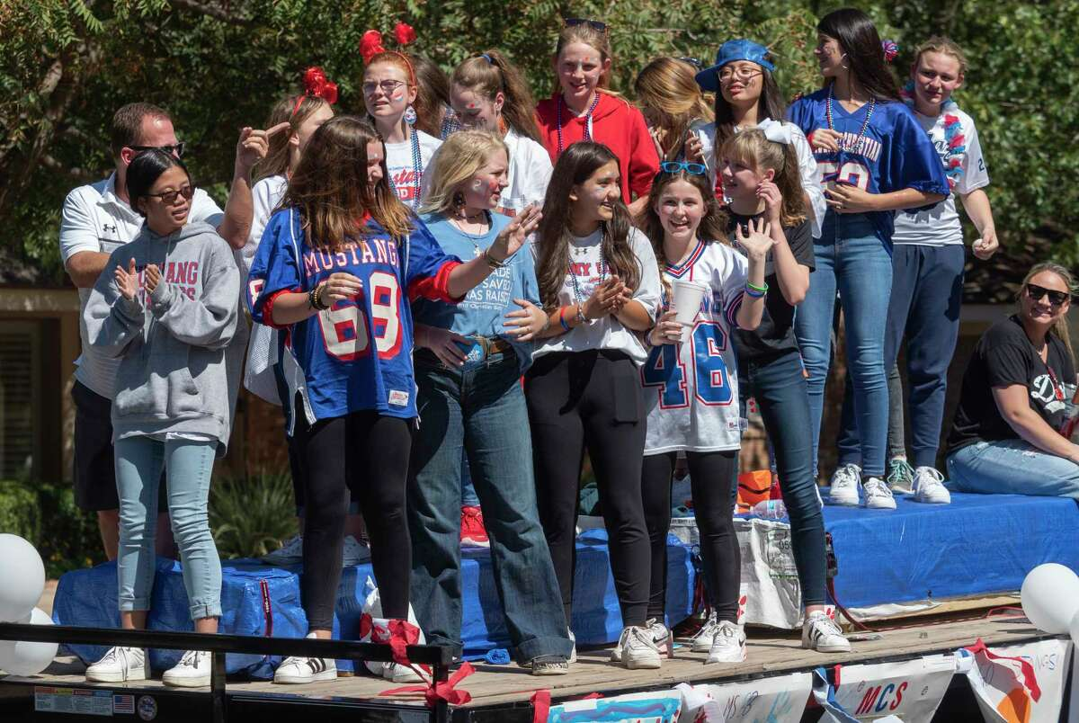 Midland Christian students and supporters walk, march and ride during the 2021 homecoming parade 10/08/2021 as they make their way toward Midland Christian School. Tim Fischer/Reporter-Telegram