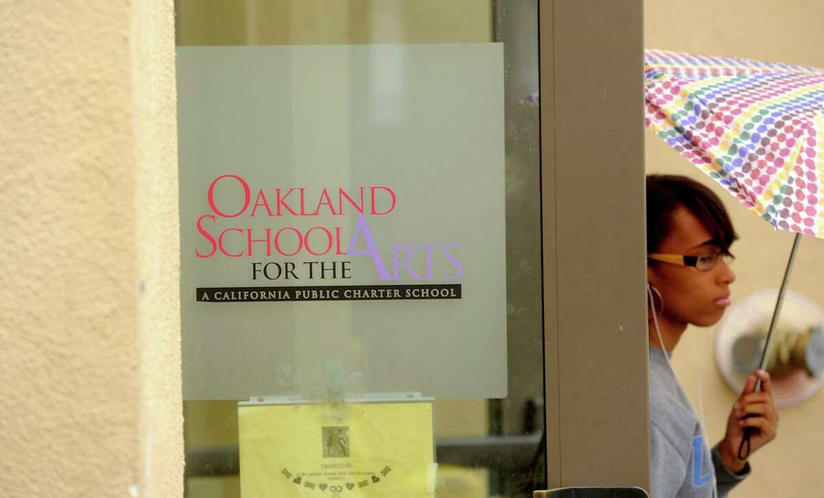A student leaves Oakland School for the Arts, located within the Fox Theater, in 2011.