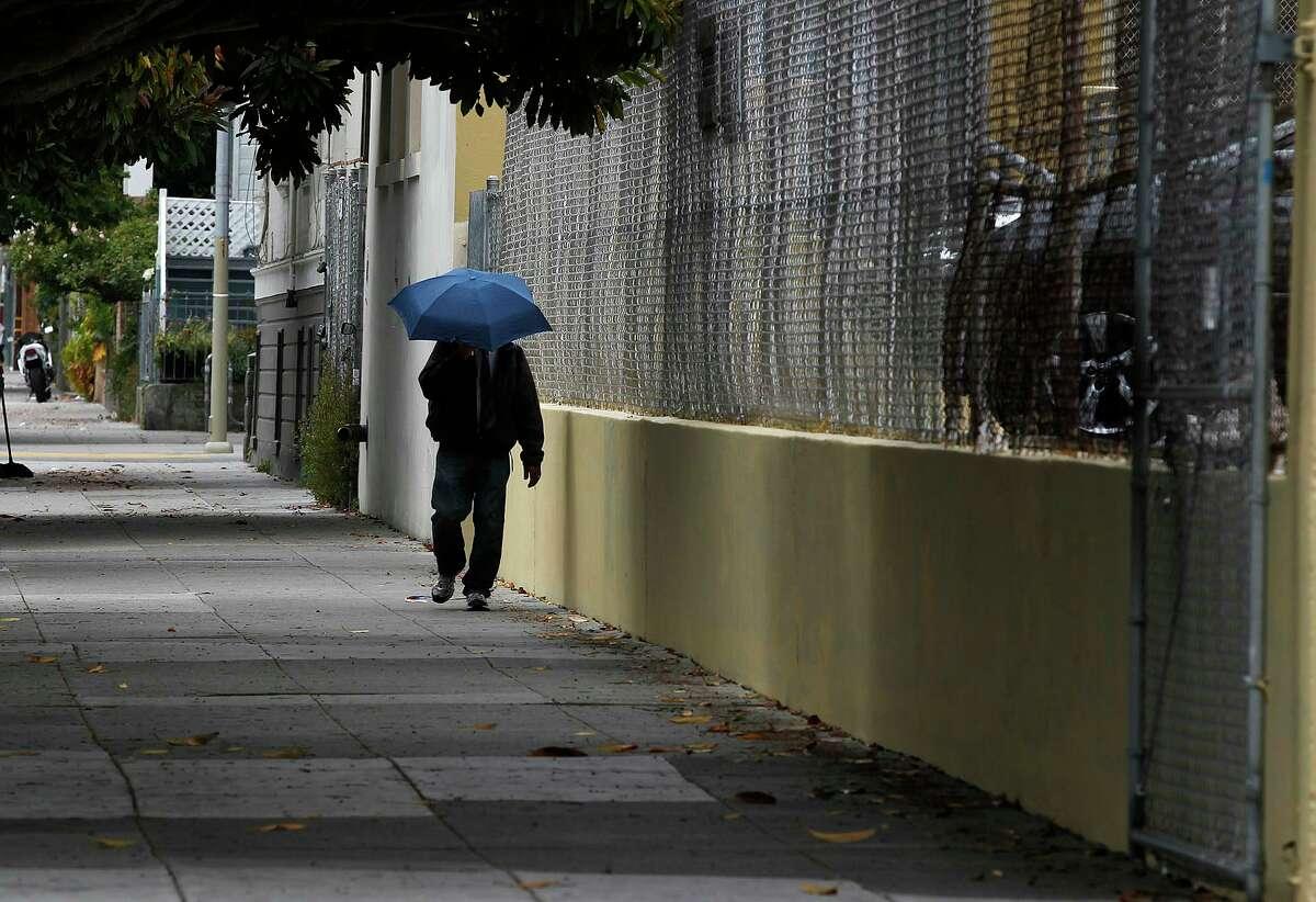 A man walks past Buena Vista Horace Mann School in San Francisco.