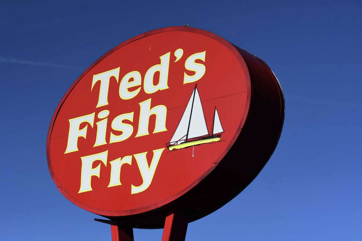 sign for the Wolf Rd. Ted?•s Fish Fry on Friday, Oct. 8, 2021, in Colonie, N.Y. Ted's will close its doors for several days as it gives employees the time to take much needed time off for their mental health.