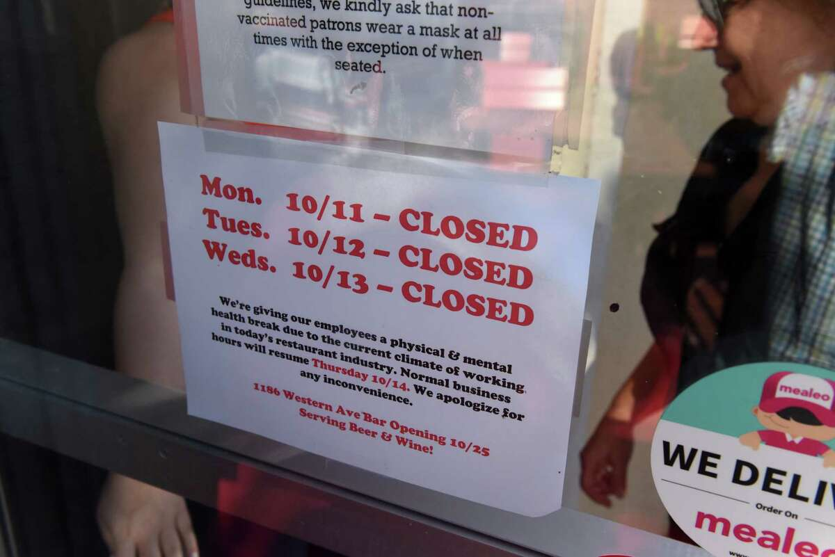 A notice on the Wolf Rd. Ted?•s Fish Fry front door alerts customers of an upcoming closing on Friday , Oct. 8, 2021, in Colonie, N.Y. Ted's will close its doors for several days as it gives employees the time to take much needed time off for their mental health.