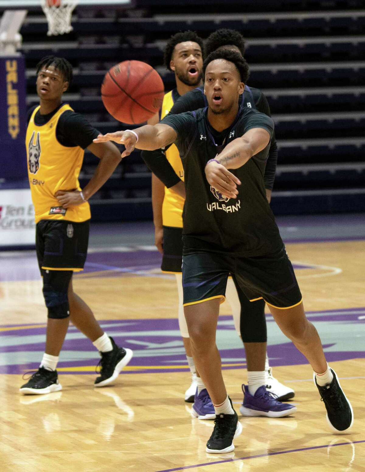 University at Albany basketball player Paul Newman passes the ball during practice at the SEFCU Arena on Thursday, Oct, 7, 2021 in Albany, N.Y.
