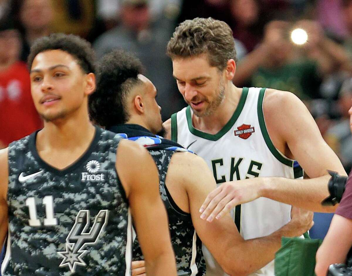 Pau Gasol #17 of the Milwaukee Bucks hugs Derrick White #4 of the San Antonio Spurs at the end of the game.. Milwaukee Bucks v San Antonio Spurs at the AT&T Center on Monday, March 10, 2019.