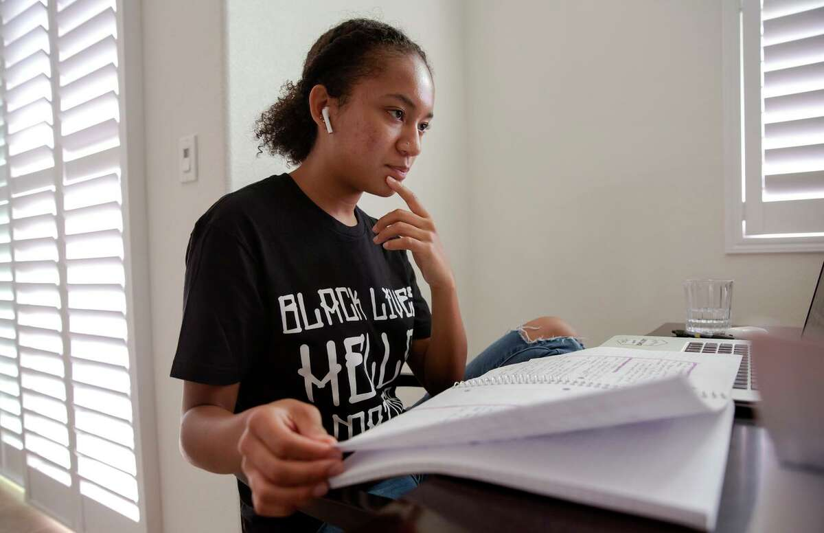 Aniyah Story looks through her notes during her Advanced Placement American history class at her San Leandro home. She supported AB331, which will make ethnic studies a graduation requirement for high school students. Gov. Gavin Newsom signed the bill into law Friday.