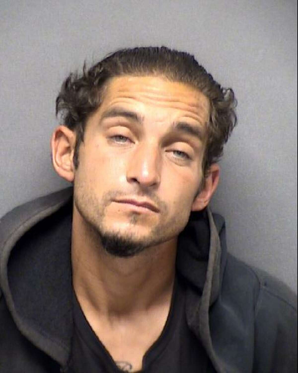 Inmate Justin Martinez, 36, is charged with escape after he was apprehended Friday while attempting to run from the Bexar County Jail.