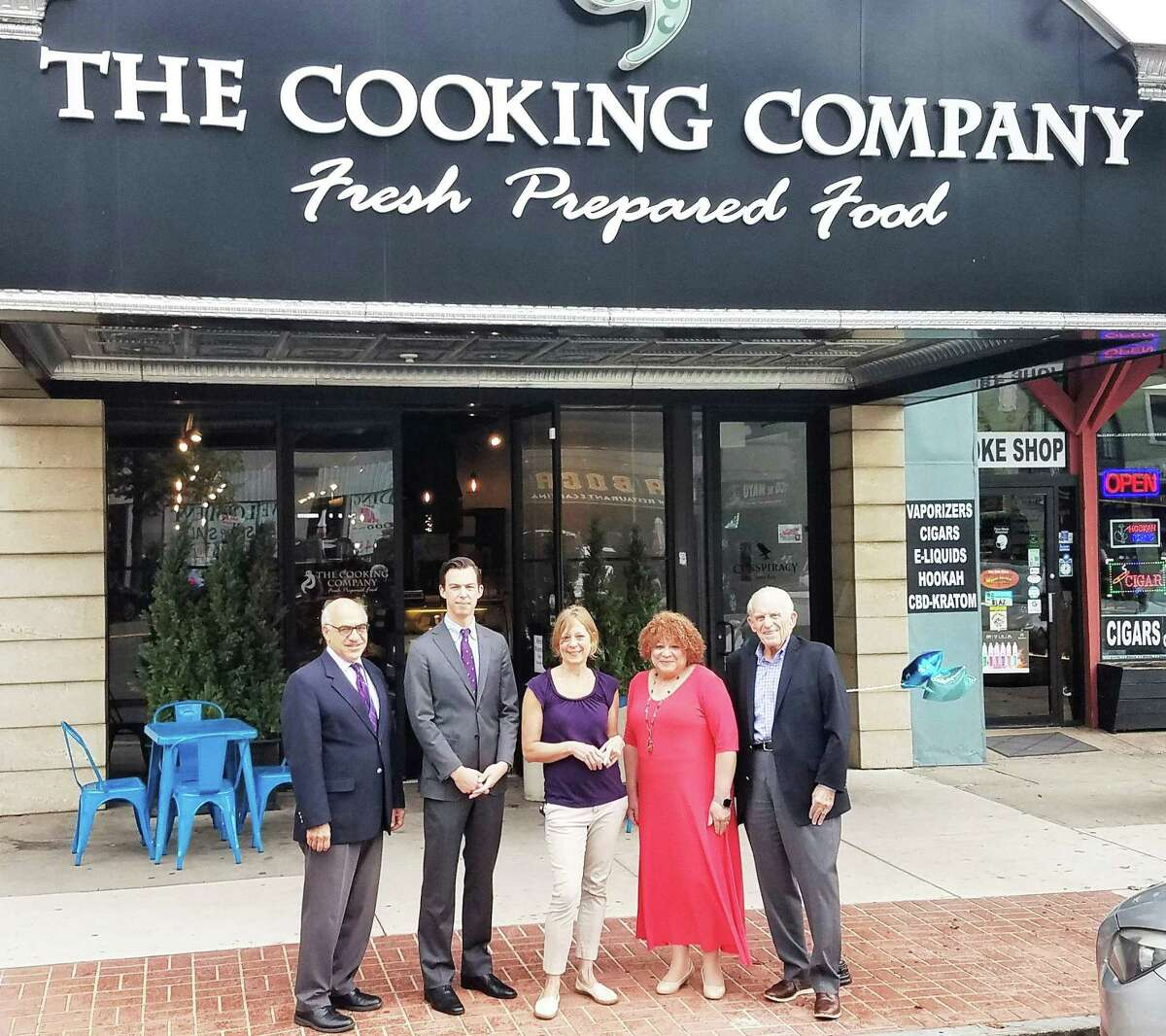 The Cooking Co. in Middletown celebrated its reopening Oct. 5. From left are Economic Development Specialist Thomas Marano, Mayor Ben Florsheim, owner Sue Bauer, Central Business Bureau Chairwoman Pamela Steele, and Middlesex County Chamber of Commerce President Larry McHugh.