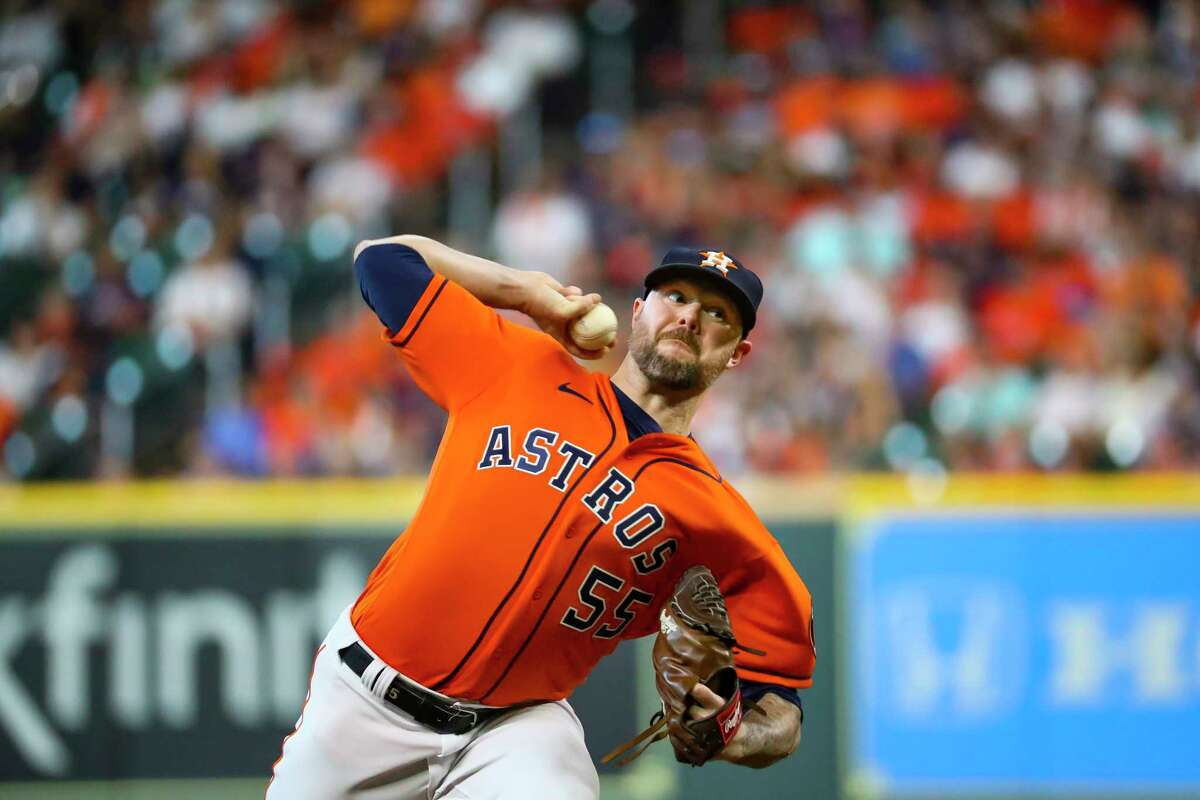 Houston Astros relief pitcher Ryan Pressly (55) pitches during the seventh inning in Game 2 of the American League Division Series on Friday, Oct. 8, 2021, at Minute Maid Park in Houston.