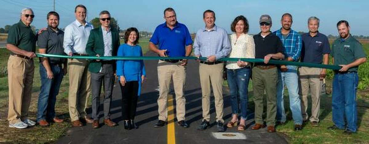 Celebrating the Silver Creek Trail Extension in Troy on Friday morning were, from left, former MCT Managing Director Jerry Kane, Phillip Jones of Oates Associates, Madison County Administrator Dave Tanzyus, MCT Managing Director SJ Morrison, Madison County Board Member Stacey Pace, Troy Mayor Dave Nonn, MCT Board Members Allen Adomite and Kelly Schmidt, MCT Board Chairman Ron Jedda, Jason Govreau of Keller Construction, MCT Director of Engineering Mark Steyer, and MCT Assistant Project Manager Jon Martin.