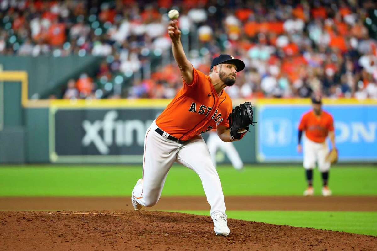 Houston Astros relief pitcher Kendall Graveman (31) pitches during the ninth inning in Game 2 of the American League Division Series on Friday, Oct. 8, 2021, at Minute Maid Park in Houston.
