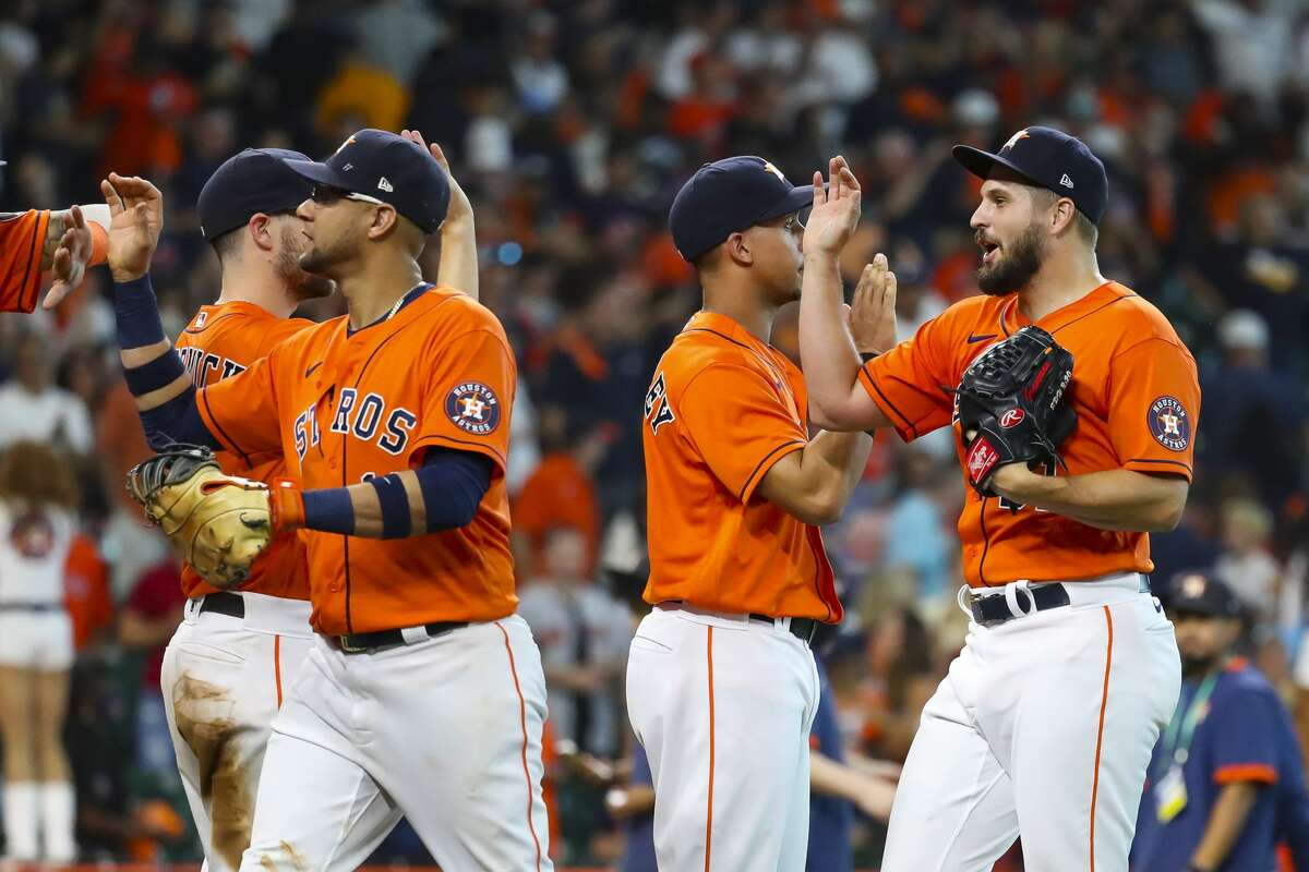 Houston Astros relief pitcher Kendall Graveman (31) celebrates the Astros 9-4 win in Game 2 of the American League Division Series on Friday, Oct. 8, 2021, at Minute Maid Park in Houston.